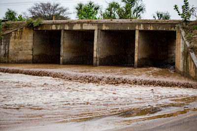 Rain-omo-valley-river-bridge-mud-road-ethiopia-adventuresinethiopia