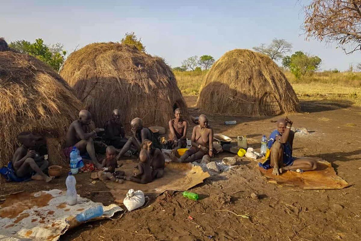omo-valley-mursi-tribe-dinner-family-ethiopia-adventuresinethiopia