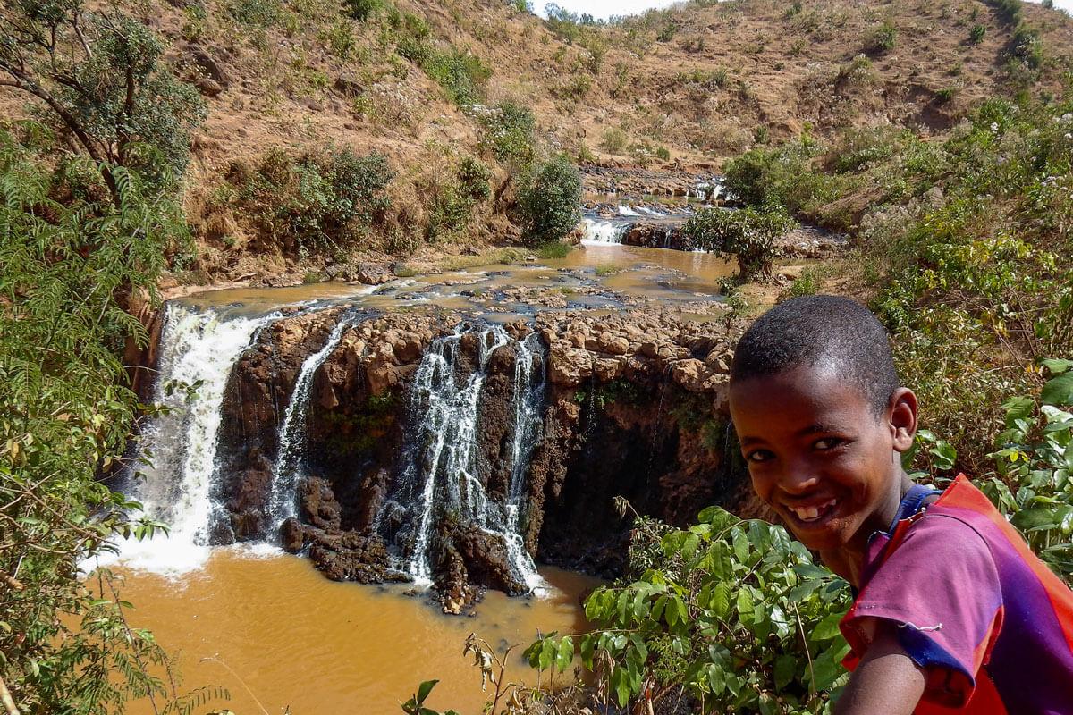 waterfall-adioura-river-omo-valley-boy-ethiopia-adventuresinethiopia