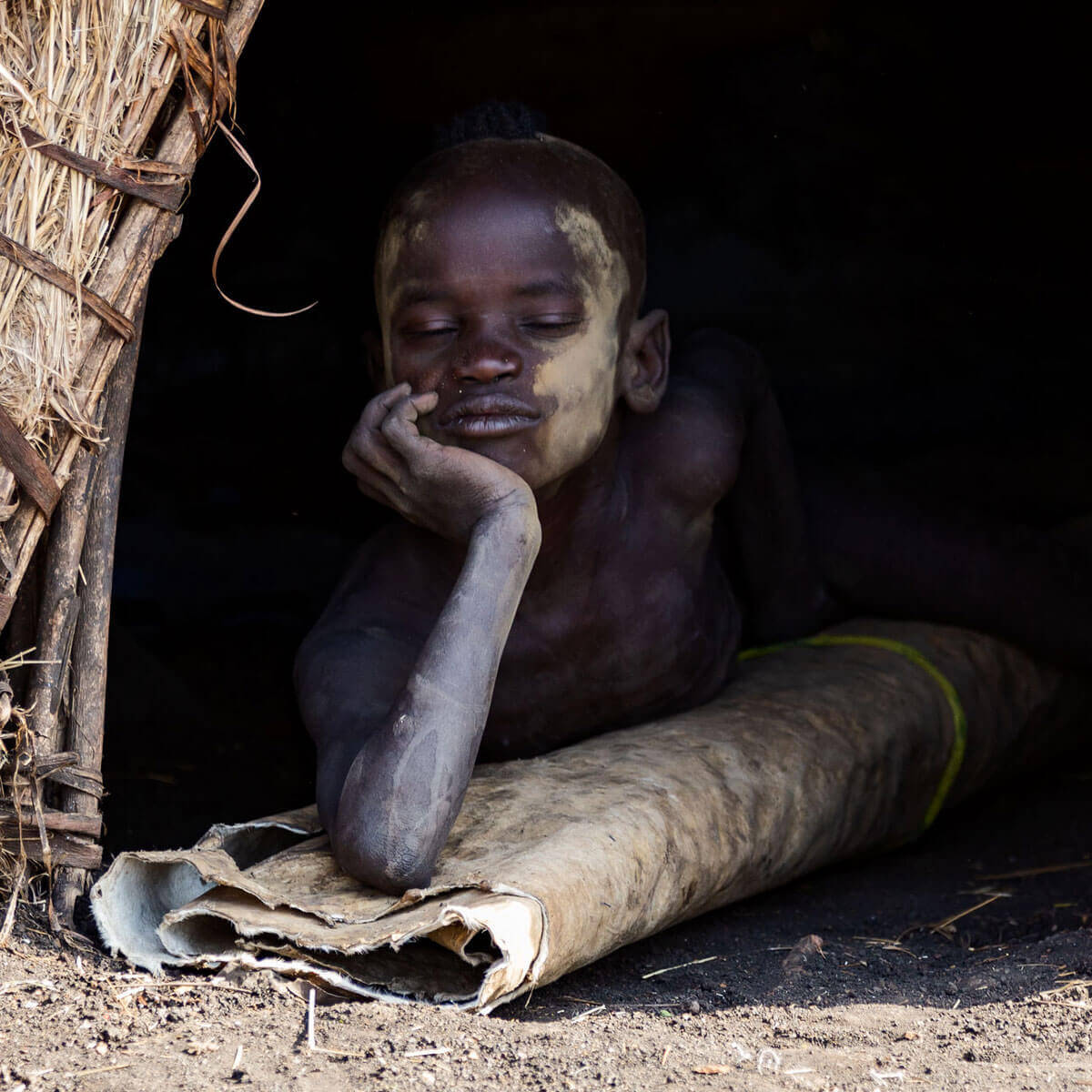 ETHIOPIA_TRIBES_MURSI_SURMA_OMO_VALLEY_BOY_Hut_Africa_country_traveling_trip_adventuresinethiopia