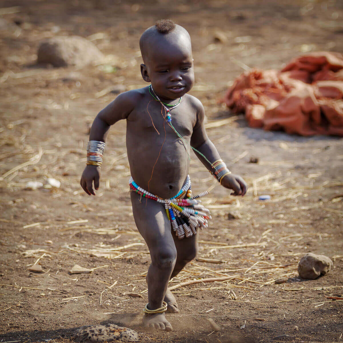 Ethiopia_Mursi_tribe_kids_baby_playing_village_Surma_Jinka_Africa_country_traveling_family_adventuresinethiopia
