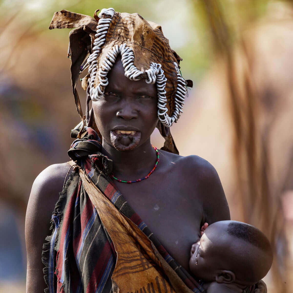 Ethiopia_mursi_tribe_surma_suri_lipplate_kids_baby_omo_valley_traveling_thebesttime_visiting_village_adventuresinethiopia