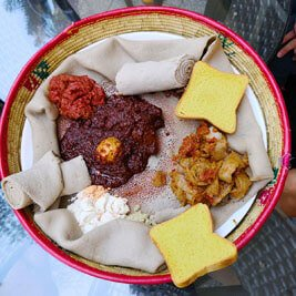 Ethiopian-traditional-meal-dish-bread-injera-tef-doro-wat-traveling