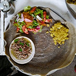 Ethiopian-traditional-meal-dinner-lunch-local-bread-injera-meat-vegetabl;e-stew