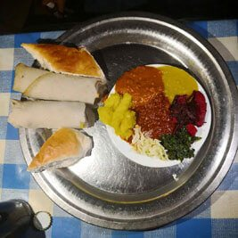 Local-bread-injera-wat-steaw-vegetables-meal
